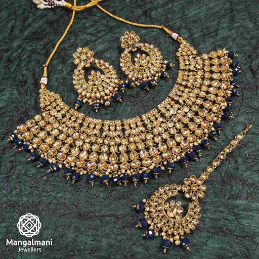 Magnificent Navy Blue Coloured With Ethnic Work AD Kundan Necklace Set Adorned With AD Kundan